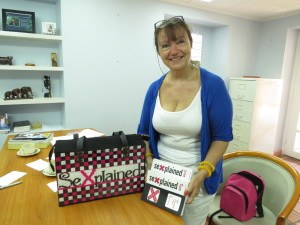Helen, with her books in the office of Barbados FPA's CEO